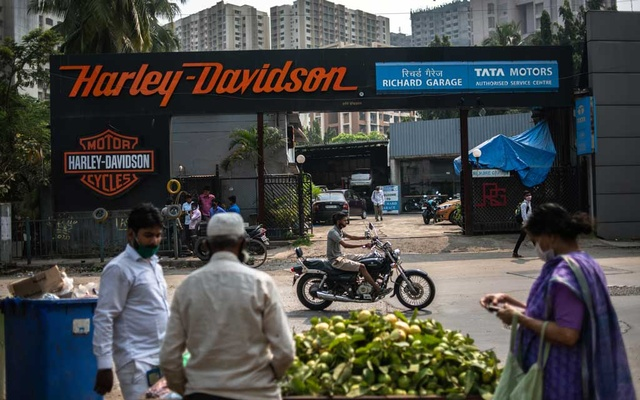 A motorcyclist drives past a Harley-Davidson outlet and workshop in Mumbai, India, on Nov 2, 2020. The New York Times