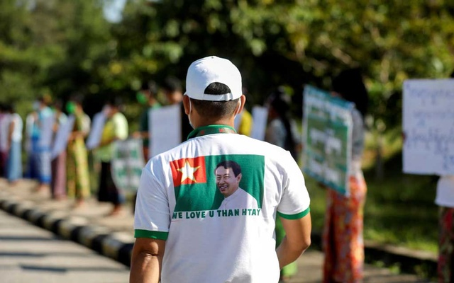 A supporter of Myanmar's military-backed opposition Union Solidarity and Development Party (USDP) wears a t-shirt promoting their leader Than Htay as they protest election results in front of Union Election Commission in Naypyitaw, Myanmar Nov 11, 2020. REUTERS/FILE