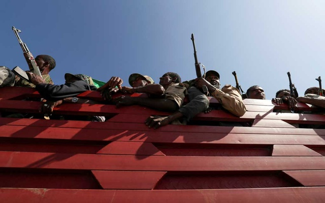 Members of Amhara region militias ride on their truck as they head to the mission to face the Tigray People's Liberation Front (TPLF), in Sanja, Amhara region near a border with Tigray, Ethiopia November 9, 2020. Reuters
