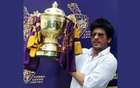 Bollywood actor Shah Rukh Khan displays the Indian Premier League (IPL) cricket trophy during a news conference at his residence in Mumbai May 30, 2012. REUTERS/Vivek Prakash