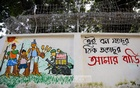 A graffiti painted on a wall on the Dhaka University campus depicts protests in Bandarban against the construction of Sikder Group's 5-star hotel and tourist spot by evicting members of the Mro community from hills. Photo: Mahmud Zaman Ovi