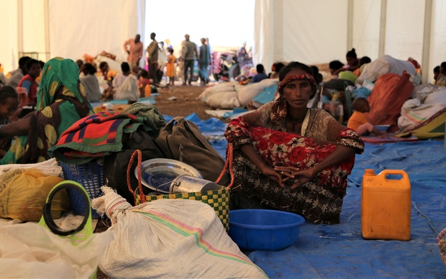 Ethiopians who fled the ongoing fighting in Tigray region, wait to be processed for emergency food and logistics support by the World Food Program in Hamdait village on the Sudan-Ethiopia border in eastern Kassala state, Sudan November 17, 2020. Picture taken November 17, 2020. World Food Program/Handout via REUTERS