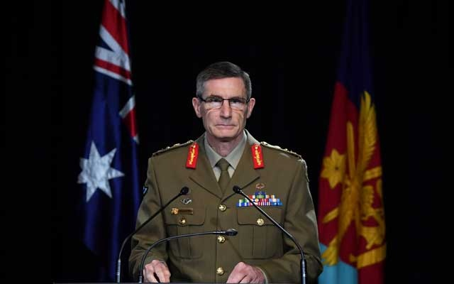 Chief of the Australian Defence Force (ADF) General Angus Campbell delivers the findings from the Inspector-General of the Australian Defence Force Afghanistan Inquiry, in Canberra, Australia, Nov 19, 2020. REUTERS