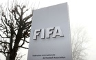 FIFA's logo is seen in front of its headquarters during a foggy autumn day in Zurich, Switzerland Nov 18, 2020. REUTERS