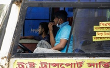 The government has made it mandatory for people to wear mask in public amid the coronavirus outbreak, but the use of the protection is decreasing. Drivers and helpers of local buses in Dhaka often violate the mask rules. Photo: Mahmud Zaman Ovi