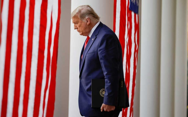 US President Donald Trump walks down the West Wing colonnade from the Oval Office to the Rose Garden to deliver an update on the so-called