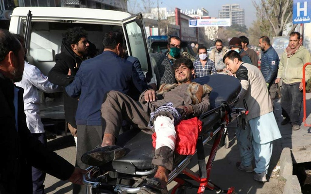 An injured man is carried to a hospital after rockets hit residential areas in Kabul, Afghanistan Nov 21, 2020. REUTERS