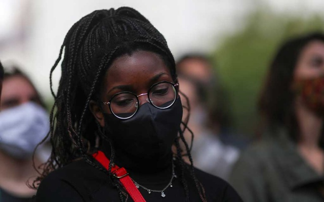 A demonstrator participates in a march in Sao Paulo on National Black Consciousness Day and in protest against the death of Joao Alberto Silveira Freitas, a Black man beaten to death at a market in Porto Alegre, Brazil, Nov 20, 2020. REUTERS