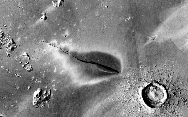An image from NASA's Mars Reconnaissance Orbiter shows a deposit in the Cerberus Fossae region on Mars that might be evidence of a recent pyroclastic volcanic eruption. Not thought to be volcanically active, Mars may have experienced an eruption just 53,000 years ago. (NASA/JPL/MSSS/The Murray Lab via The New York Times)