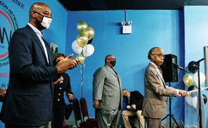 Raymond McGuire, a vice chairman at Citigroup and mayoral candidate, applauds as the Rev Al Sharpton speaks in Harlem on Oct 3, 2020. Next year's mayoral election will decide who will steer New York City through a difficult recovery from the pandemic. Simbarashe Cha/The New York Times