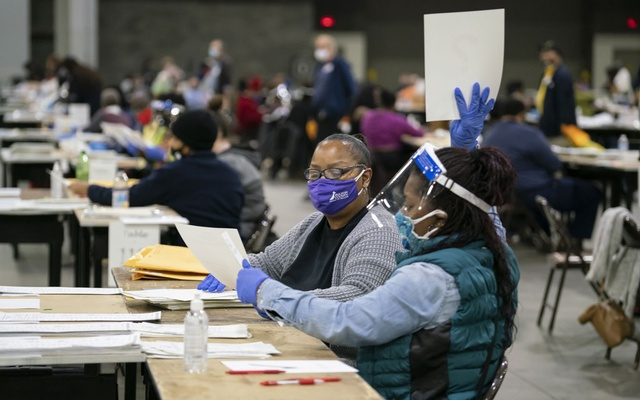 Election workers recount ballots in Atlanta on Nov. 14, 2020. Joe Biden was certified as the winner in Georgia, and Michigan Republicans said they had no information that would change the tally in a state Biden also won. (Nicole Craine/The New York Times)