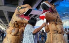 Dinosaur costumed actors representing Thailand's establishment at a high school student led protest in Bangkok, Thailand November 21, 2020.