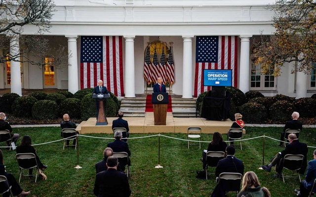 FILE -- Vice President Mike Pence, left, delivers an update on Operation Warp Speed from the Rose Garden of the White House in Washington on Friday, Nov 13, 2020, as President Donald Trump looks on. (Anna Moneymaker/The New York Times)