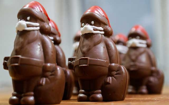 Chocolate Santas wearing protective face masks are seen in the workshop of the Hungarian confectioner Laszlo Rimoczi, during the coronavirus disease (COVID-19) outbreak in Lajosmizse, Hungary, November 20, 2020. REUTERS