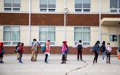 Students arriving to class in Scarborough, outside of Toronto, in September. Despite Toronto's new coronavirus restrictions, classes will remain open. Reuters