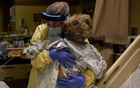 Healthcare personnel prepare to discharge a patient who had been quarantining after a possible exposure to the coronavirus disease (COVID-19) at a hospital in Lakin, Kansas, US, Nov 19, 2020. REUTERS