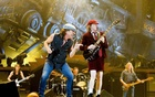 Rock band AC/DC lead guitarist Angus Young (R) and vocalist Brian Johnson perform during a concert at the Telenor Arena in Fornebu, near Oslo February 18, 2009. REUTERS