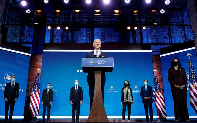 President-elect Joe Biden stands with his nominees for his national security team at his transition headquarters in the Queen Theater in Wilmington, Delaware, U.S., November 24, 2020. (L-R), are: Antony Blinken to be secretary of state; Jake Sullivan to be U.S. national security adviser; Alejandro Mayorkas to be secretary of Homeland Security; Avril Haines to be director of national intelligence; John Kerry to be a special envoy for climate change; and Ambassador to the United Nations-nominee Linda Thomas-Greenfield, who stands behind Vice President-elect Kamala Haris. Reuters