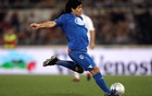Argentine football great Diego Armando Maradona kicks the ball during a charity soccer match called
