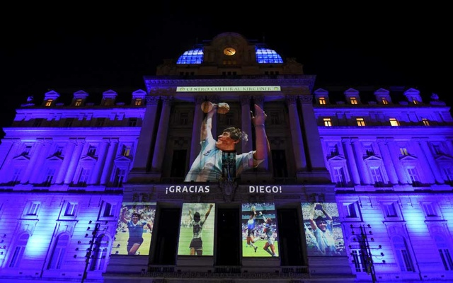 Photographs of the late soccer legend Diego Maradona are projected on the Kirchner Cultural Centre, in Buenos Aires, Argentina, Nov 25, 2020. REUTERS
