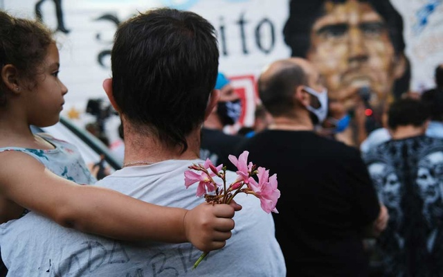 Fans gather to mourn the death of soccer legend Diego Maradona, outside the Diego Armando Maradona stadium, in Buenos Aires, Argentina, Nov 25, 2020. REUTERS