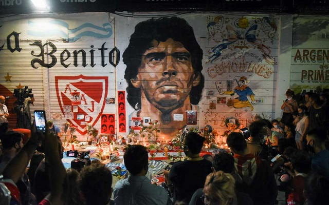 People gather to mourn the death of soccer legend Diego Maradona, outside the Diego Armando Maradona stadium, in Buenos Aires, Argentina, Nov 25, 2020. REUTERS