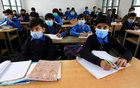 Students wear protective masks as they attend a class at school as the outbreak of the coronavirus disease (COVID-19) continues, in Peshawar, Pakistan November 23, 2020. Reuters