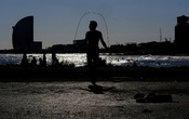 A man skips rope as he exercises at Barceloneta beach, after Spain's Catalonia region said it would allow gyms to reopen from Monday amidst the coronavirus outbreak, in Barcelona, Spain November 22, 2020. REUTERS