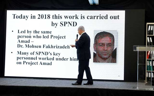 Israeli Prime Minister Benjamin Netanyahu points at a screen with an image of Iranian nuclear scientist Mohsen Fakhrizadeh during a news conference at the Ministry of Defence in Tel Aviv, Israel, April 30, 2018. Picture taken April 30, 2018. REUTERS/ Amir Cohen