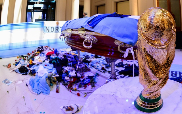 A replica of the World Cup Trophy stands next to the casket of soccer legend Diego Maradona at the presidential palace Casa Rosada, in Buenos Aires, Argentina November 26, 2020. Argentina Presidency, Handout via Reuters.