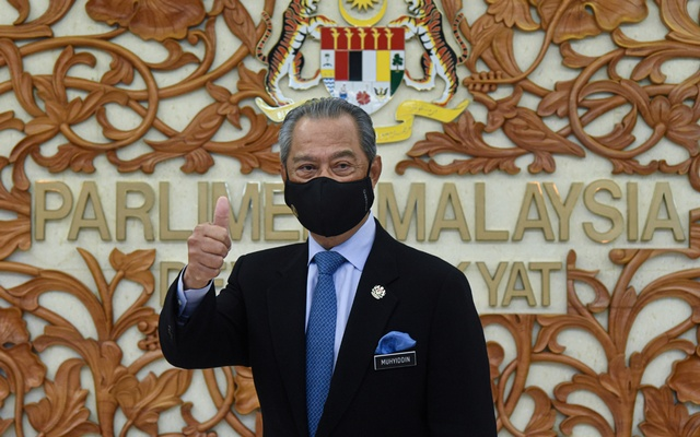 Malaysia's Prime Minister Muhyiddin Yassin poses for a picture at the parliament, in Kuala Lumpur, Malaysia Nov 26, 2020. Reuters