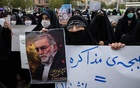 A protester holds an image of the Iranian nuclear scientist Mohsen Fakhrizadeh during a demonstration in Tehran on Saturday, Nov. 28, 2020, a day after Fakhrizadeh was killed. The killing of Iran's top nuclear scientist, which Tehran blamed on Israel, raised fears of an escalation in violent retribution. (Arash Khamooshi/The New York Times)