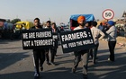 Farmers carry placards at a site of a protest against the newly passed farm bills at Singhu border near Delhi, India, November 28, 2020. REUTERS/Anushree Fadnavis