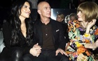 FILE -- Amazon's chief executive, Jeff Bezos, with his girlfriend, Lauren Sanchez, left, and the fashion editor Anna Wintour at a fashion show in Los Angeles, Feb 7, 2020. Luxury brands were late to embrace e-commerce. When they did, many depended on either Farfetch or Yoox, rejecting the overtures of giants like Amazon. (Calla Kessler/The New York Times)