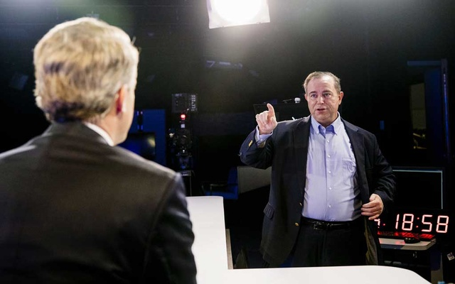 Christopher Ruddy, CEO of Newsmax, talks with Newsmax anchor John Bachman on the set of a Newsmax television studio in Boca Raton, Fla, Nov 19, 2020. The New York Times