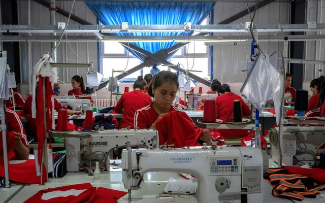 Young Uighur women work in a garment factory in Hotan, in the Xinjiang region of China on Aug. 3, 2019. American lawmakers unveiled legislation on Wednesday, March 11 that, if passed, would tightly restrict imports to the United States from the Xinjiang region of western China, the toughest response yet to Beijing's mass detention of minorities and coercive labour practices there spelling problems for brands like Calvin Klein, Tommy Hilfiger, Nike and Patagonia. (Gilles Sabrié/The New York Times)