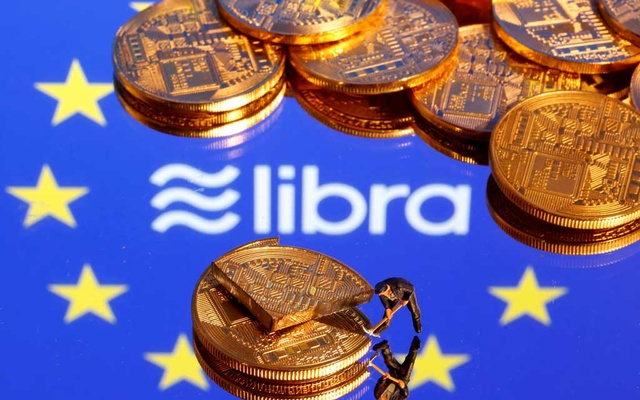 A small toy figure is seen on representations of the virtual currency on a displayed European Union flag and the Facebook Libra logo in this illustration picture, October 20, 2019. Reuters