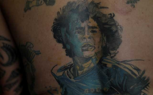 Luciano Zarate, a devoted Diego Maradona fan who has an image of Maradona tattooed on his back, poses for a photo at his home in Buenos Aires, Argentina, November 28, 2020.