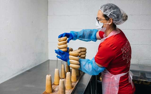"""Nichole Craddock, an operations manager at the Greater Knead, inspect bagels before packaging at the company's warehouse in Bensalem, Pa on Nov 23, 2020. Small-business owners are having to learn approaches like """"fail fast,"""" course-correcting and going virtual — and some are succeeding. (Michelle Gustafson/The New York Times)"""