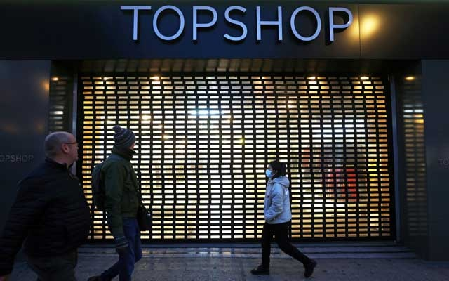 Pedestrians walk past a Topshop store, owed by Arcadia group on Oxford street in London, Britain, November 30, 2020. REUTERS