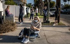 People wait outside the Exer Urgent Care to be tested for the coronavirus, in the Westwood neighbourhood of Los Angeles, Nov 24, 2020. The New York Times