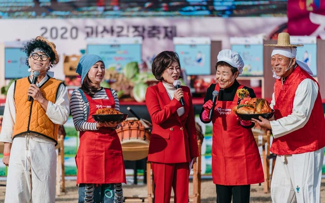 Entertainers at a kimchi making competition during the Kimjang festival in Goesan county in South Korea on Nov 7, 2020. The New York Times