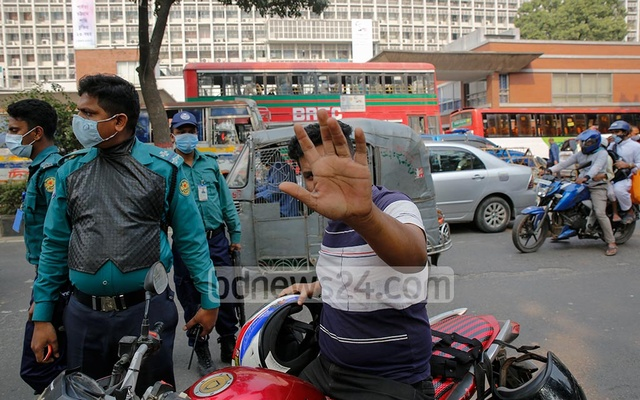 This motorcyclist was riding without a mask amid a surge in coronavirus illnesses and deaths in the country. Executive Magistrate Ujjal Kumar Haldar later fined him Tk 300 in front of the Secretariat, Dec 3, 2020. Photo: Mahmud Zaman Ovi