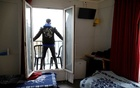 Asylum-seeker Ibrahim stands on a balcony outside his room at the Hotel Avenir Montmartre in Paris, France, Dec 2, 2020. The hotel, deserted by tourists due to COVID-19 travel bans opens its 42 rooms to the city's homeless for 12 months with the help of French charity association Emmaus Solidarite. REUTERS