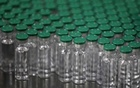 Vials of AstraZeneca's COVISHIELD, coronavirus disease (COVID-19) vaccine, are seen before they are packaged inside a lab at Serum Institute of India, Pune, India, Nov 30, 2020. REUTERS