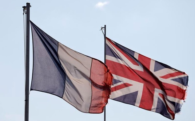 A French flag and a British national flag, known as the Union Jack, are seen in Violaines, France, October 16, 2020. Reuters