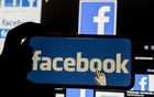 The Facebook logo is displayed on a mobile phone in this picture illustration taken December 2, 2019. Reuters