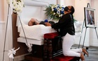 Maria Ortiz reacts while kneeling beside the body of her partner Jose Holguin, 50, originally from the Dominican Republic and who died of complications related to COVID-19, during a viewing service at International Funeral & Cremation Services in Harlem, New York City, May 16, 2020. REUTERS/Andrew Kelly