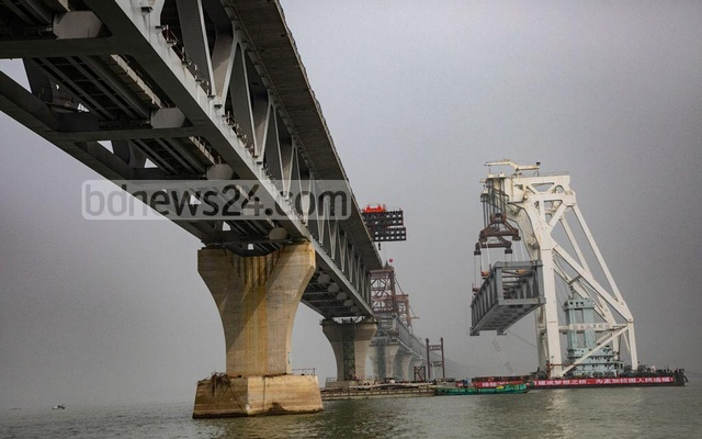 Each of the 150-metre long spans weighs around 3,200 tonnes. A floating crane from China was used to carry and install the spans from Kumarbhog Construction Yard at Mawa.