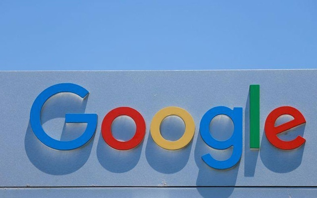 FILE PHOTO: After the company announced it would extend its coronavirus work-from-home order until summer 2021, a Google sign is shown at one of the company's office complexes in Irvine, California, US, July 27, 2020. REUTERS/Mike Blake/File Photo